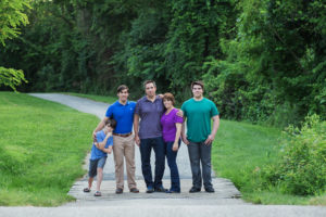 Family of five with three sons outdoors at a park